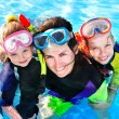 Children with mother in swimming pool. — Stock Photo #5908616