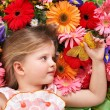 Cute child lying on the flower. — Stock Photo #5908619
