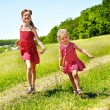 Kids running across green grass outdoor. — Stock Photo #5908650