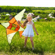 Kid flying kite outdoor. — Stock Photo #5908651