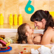 Royalty-Free Stock Photo: Mother and daughter  washing in bath.