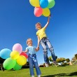 Child playing with balloons in park. — Stock Photo