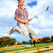 Little girl playing golf in park. — Stock Photo #5972611