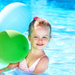 Child playing with balloons in swimming pool. — Stock Photo #5972612