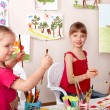 Stock Photo: Children painting in preschool.