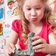 Child moulding from clay in play room. — Stock Photo #5972706