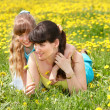 Stock Photo: Mouther with daughter outdoor.