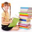 Schoolgirl reading  pile of books. - Stockfoto