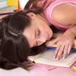 Girl sleep on pile of book. - Stockfoto