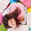 Girl reading open book . - Stockfoto