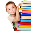 Child holding stack of books. - ストック写真