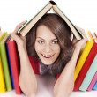 Girl with stack color book. - Stockfoto