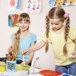 Child painting in preschool. - Stockfoto