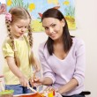 Child painting in preschool. — Stock Photo #5972958