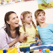Kids painting in preschool. - Stock Photo