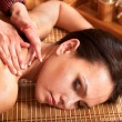 Woman getting massage in bamboo spa. — Stock Photo #5972967