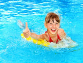 Kid on inflatable ring thumb up. — Stock Photo