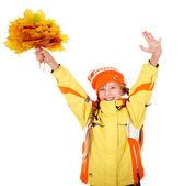 Girl in autumn orange hat holding leaves . — Stock Photo