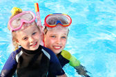 Kids in swimming pool learning snorkeling. — Stok fotoğraf