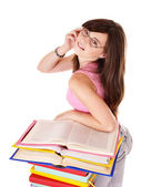 Girl with pile colored book . — Stockfoto