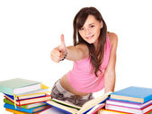 Girl with pile book showing thumb up. — Stock Photo