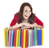 Girl in glasses with pile book . — Foto Stock