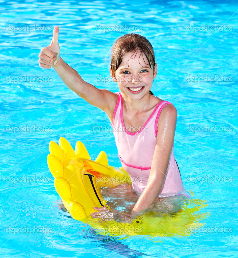 Child sitting on inflatable ring thumb up stock photo What kind of acid is used in swimming pools