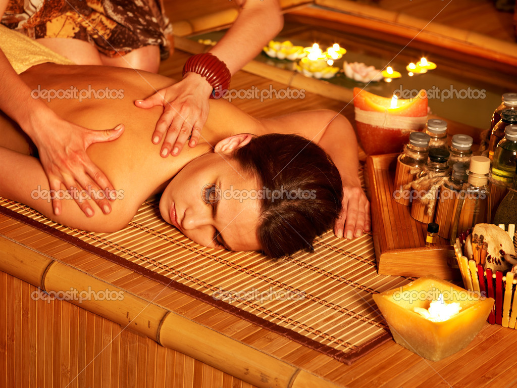Young woman getting massage in bamboo spa. — Stock Photo #5972969