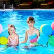 Children playing with balloons in swimming pool. — ストック写真