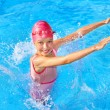 Kid swimming in pool. - Stock Photo