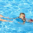 Swimming instructor learn child swim. — Stock Photo #6101827