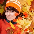 Girl in autumn orange leaves. - Stock Photo