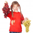 Child takes bunch of grape. - Stock Photo