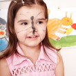 Child with paint of face. — Stock Photo