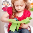 Child with scissors cut paper at home. — Stock Photo #6101864