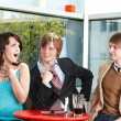 Group of happy talking in cafe. — Стоковое фото