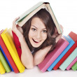 Girl with pile color book. — Stock Photo #6102126