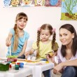 Royalty-Free Stock Photo: Child painting in preschool.