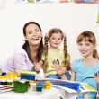 Royalty-Free Stock Photo: Children painting in preschool.