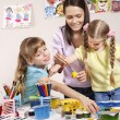Child painting in preschool. — Stock Photo