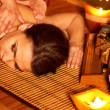Woman getting massage in bamboo spa. — Stock Photo #6102169