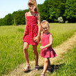 Kids walking across green grass outdoor. — Stock Photo #6102175