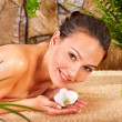 Young woman getting massage in  spa. - Stock Photo