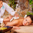 Woman getting thai herbal compress massage . — Stock Photo