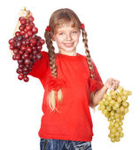 Child takes bunch of grape. — Stock Photo