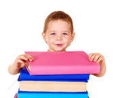 Child holding stack of books. — Stock Photo