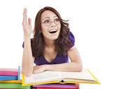 Girl in glasses with pile book . — Stockfoto
