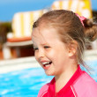 Child swimming in pool. - Stock Photo