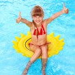 Child sitting on inflatable ring thumb up. — Stock Photo #6140199