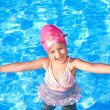 Thumb up of kid in swimming pool. — Stock Photo